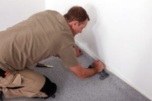 HandyManPro- Handy man installing a carpet