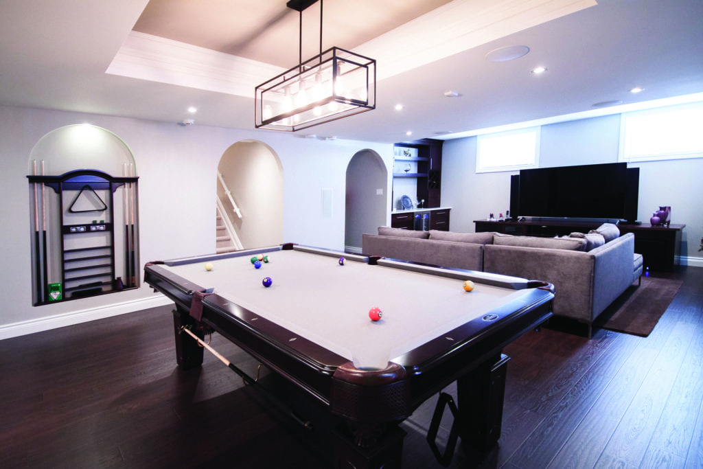 Basement living space with pool table and entertainment area