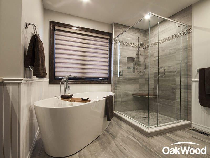Bathroom design with tub and walk in shower with glass doors